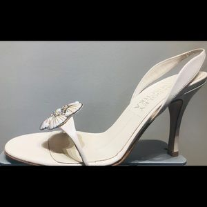 Hi heel sling back with shell ornament